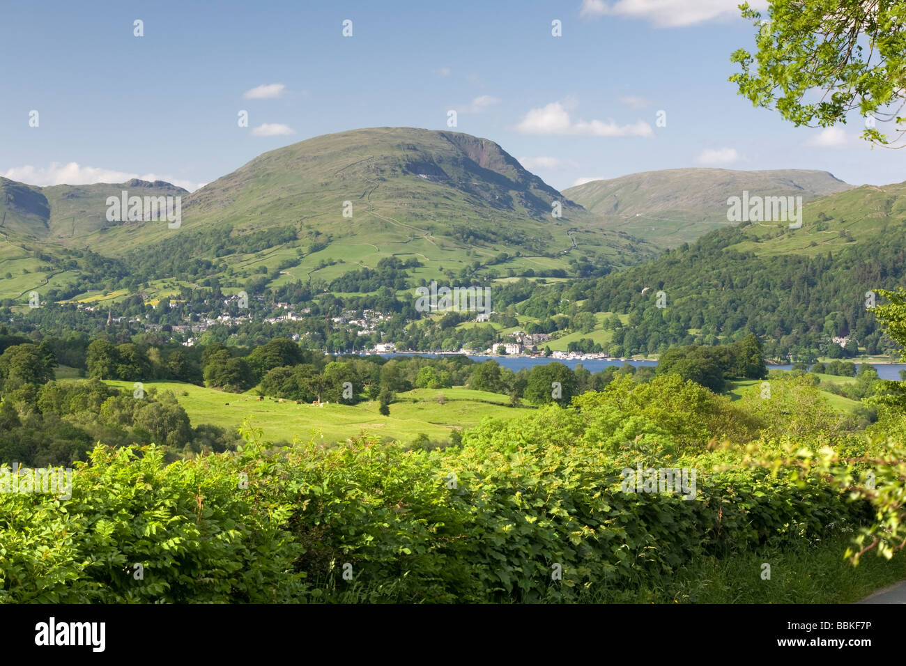 The town of Ambleside sits on the shore of Windermere in the Lake District, England - Stock Image