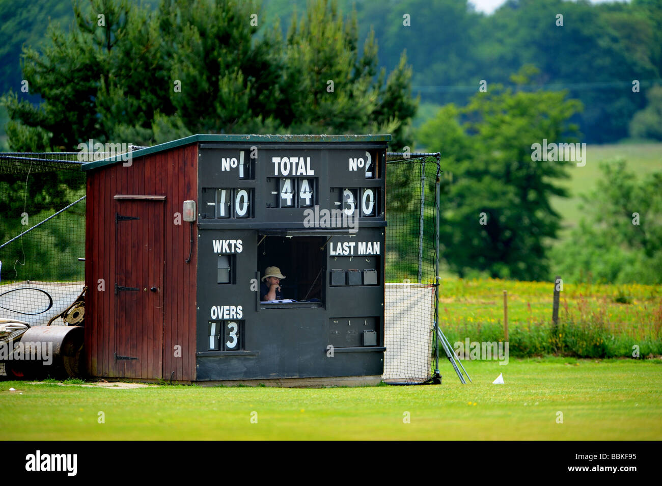 A woman notes the scores down at a local cricket match in cuckfield - Stock Image