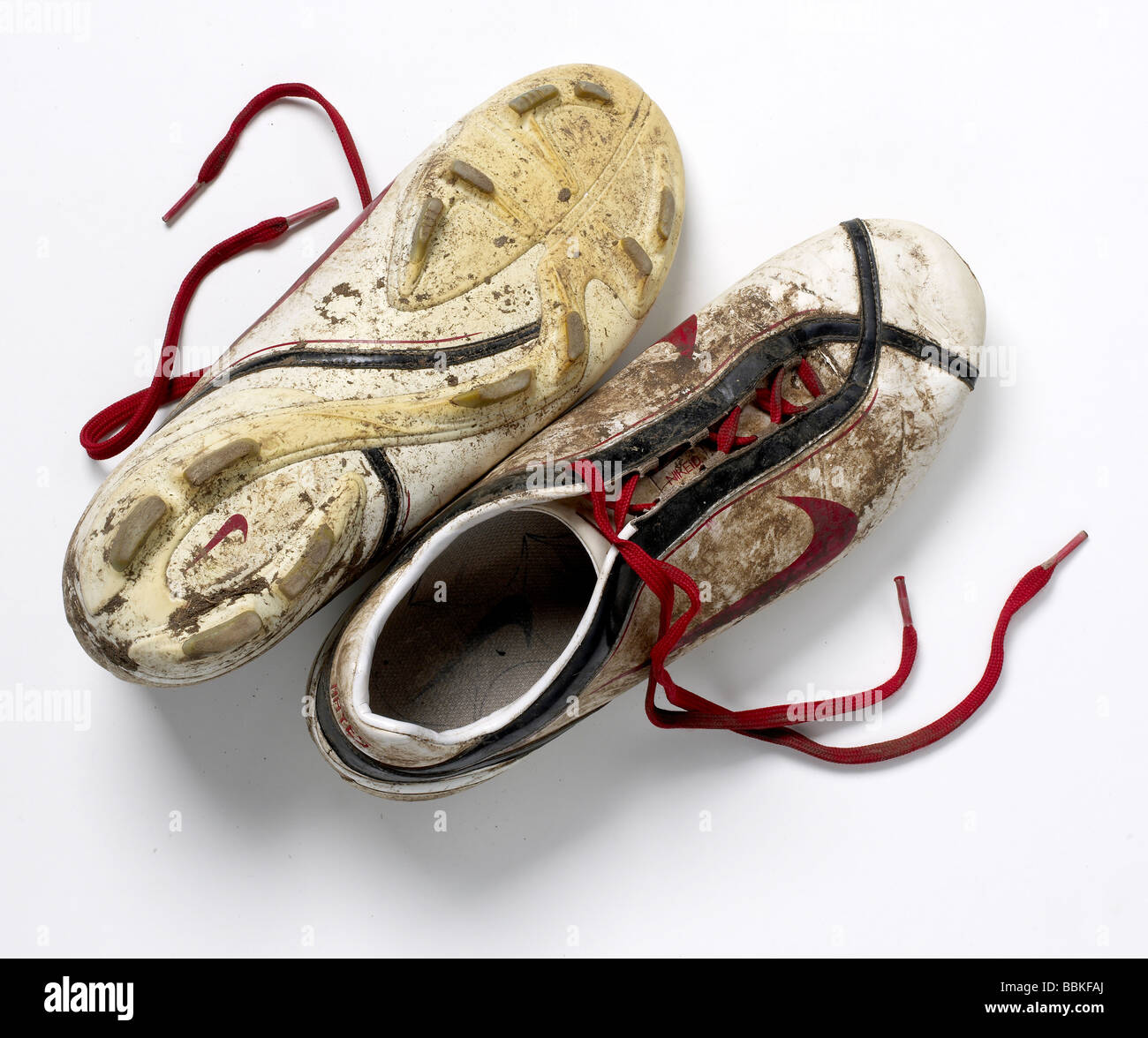 Old Dirty Soccer cleats elevated view - Stock Image