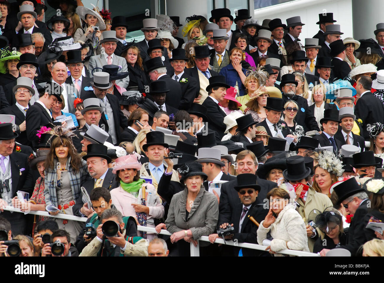A crowd of top hatted men and elegantly dressed women race goers in the enclosure  Derby Day 2009 Stock Photo