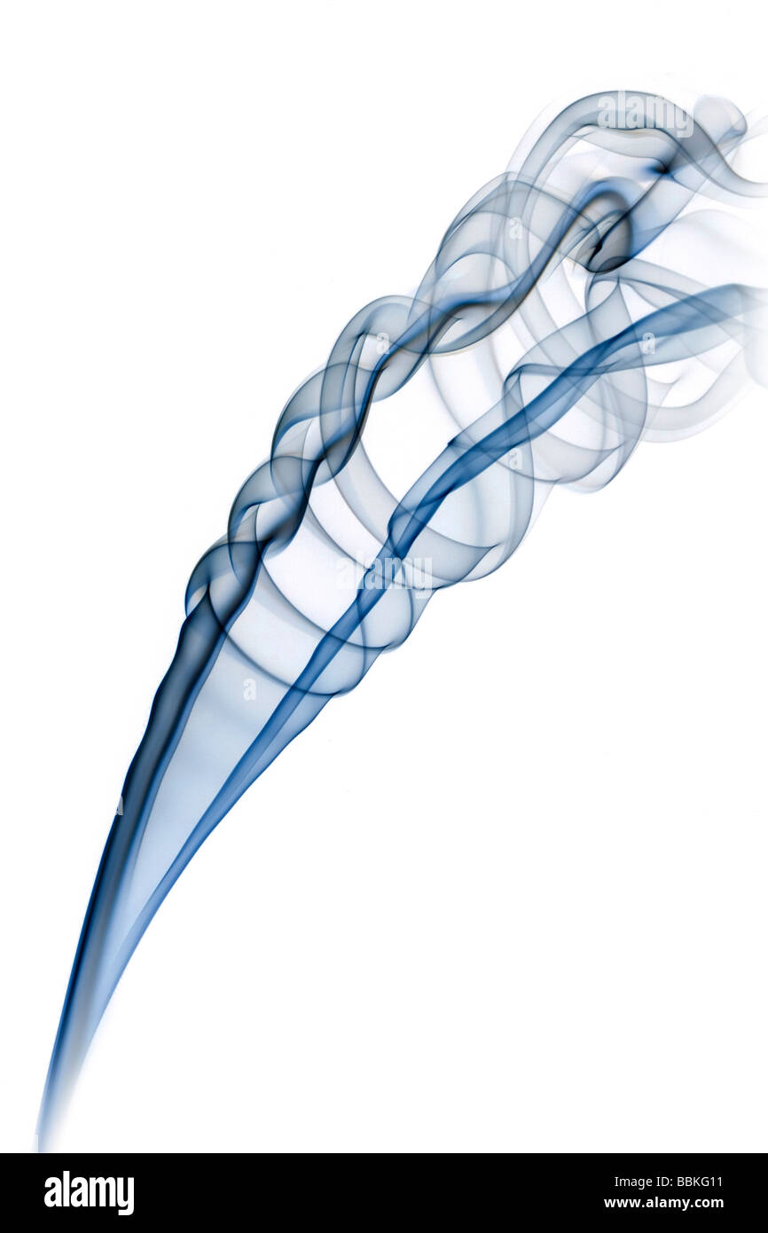 Curls of smoke given off by the slow-burning of an incense stick.Volutes de fumée dégagées par la - Stock Image