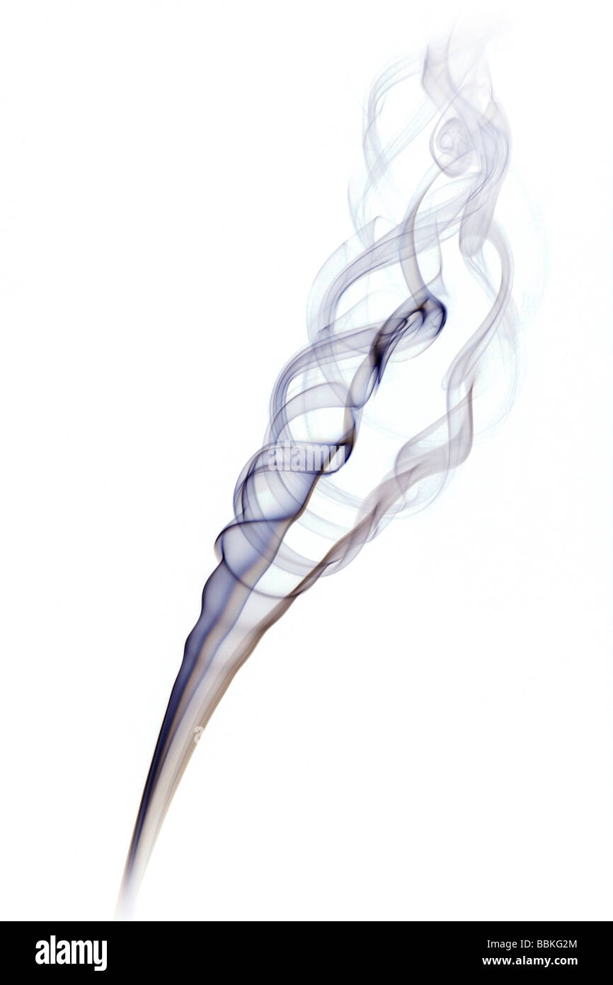 Curls of smoke given off by the combustion of an incense stick. Volutes de fumée dégagées par la - Stock Image