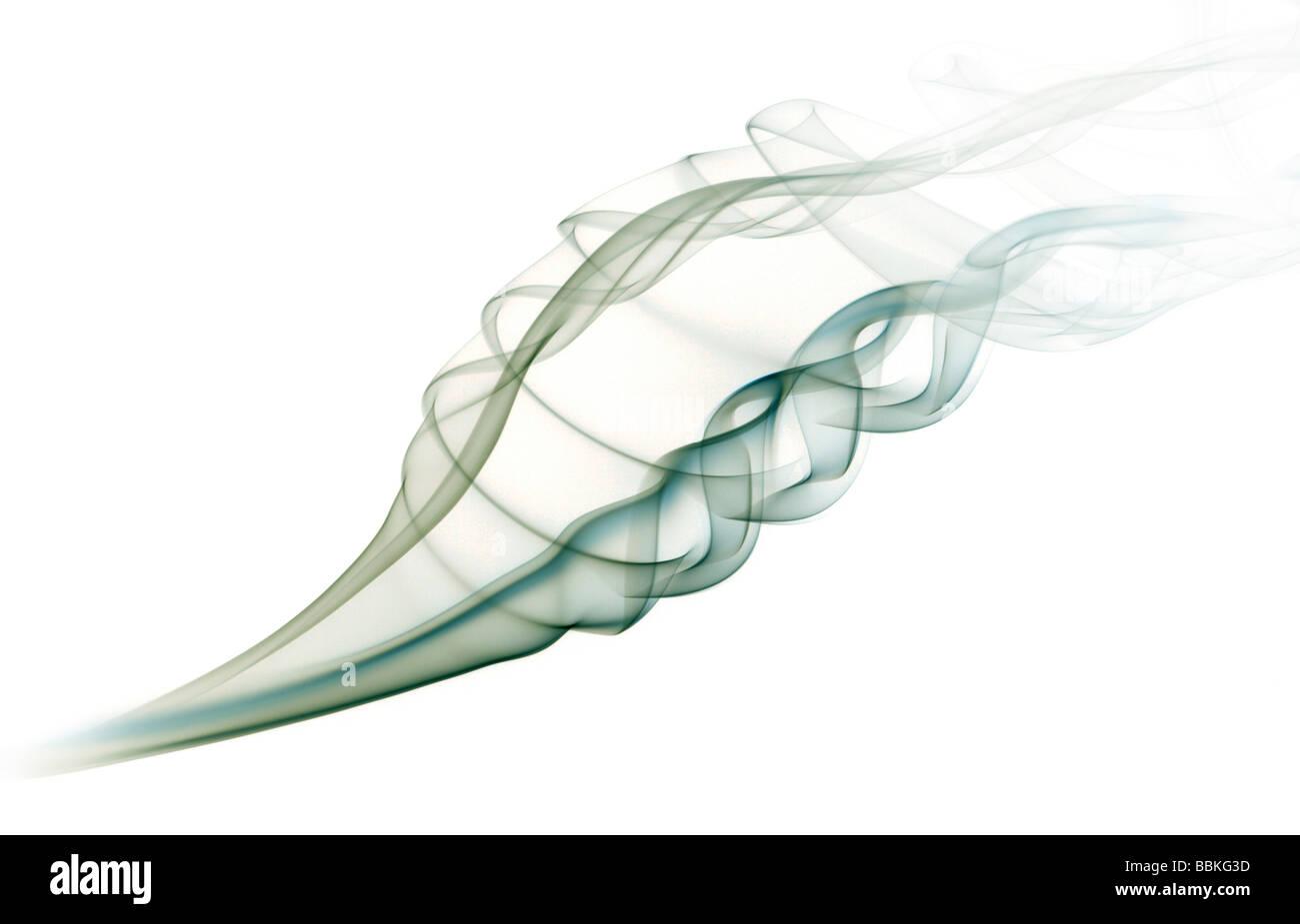 Curls of smoke given off by the combustion of an incense stick. Volutes de fumée dégagées par la combustion d'un Stock Photo