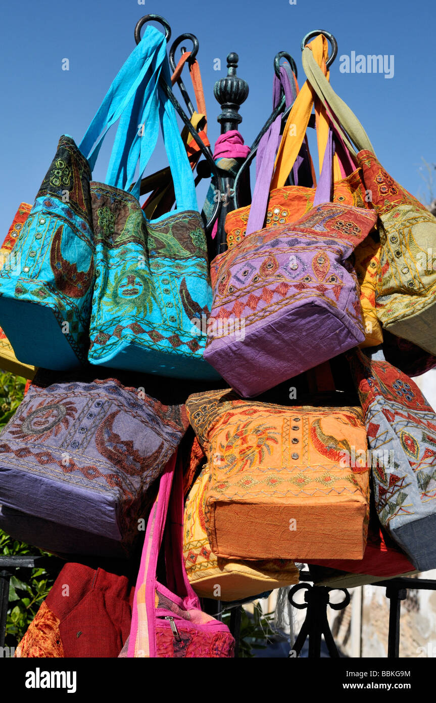 Colourful souvenir bags on display in Ronda Andalucia Spain - Stock Image