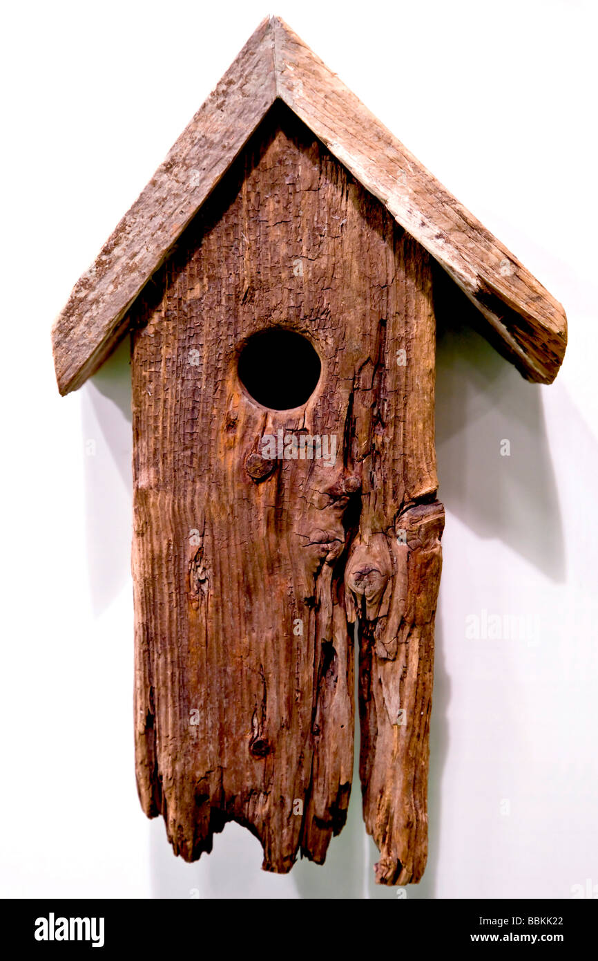 Old nesting box on the wall Stock Photo