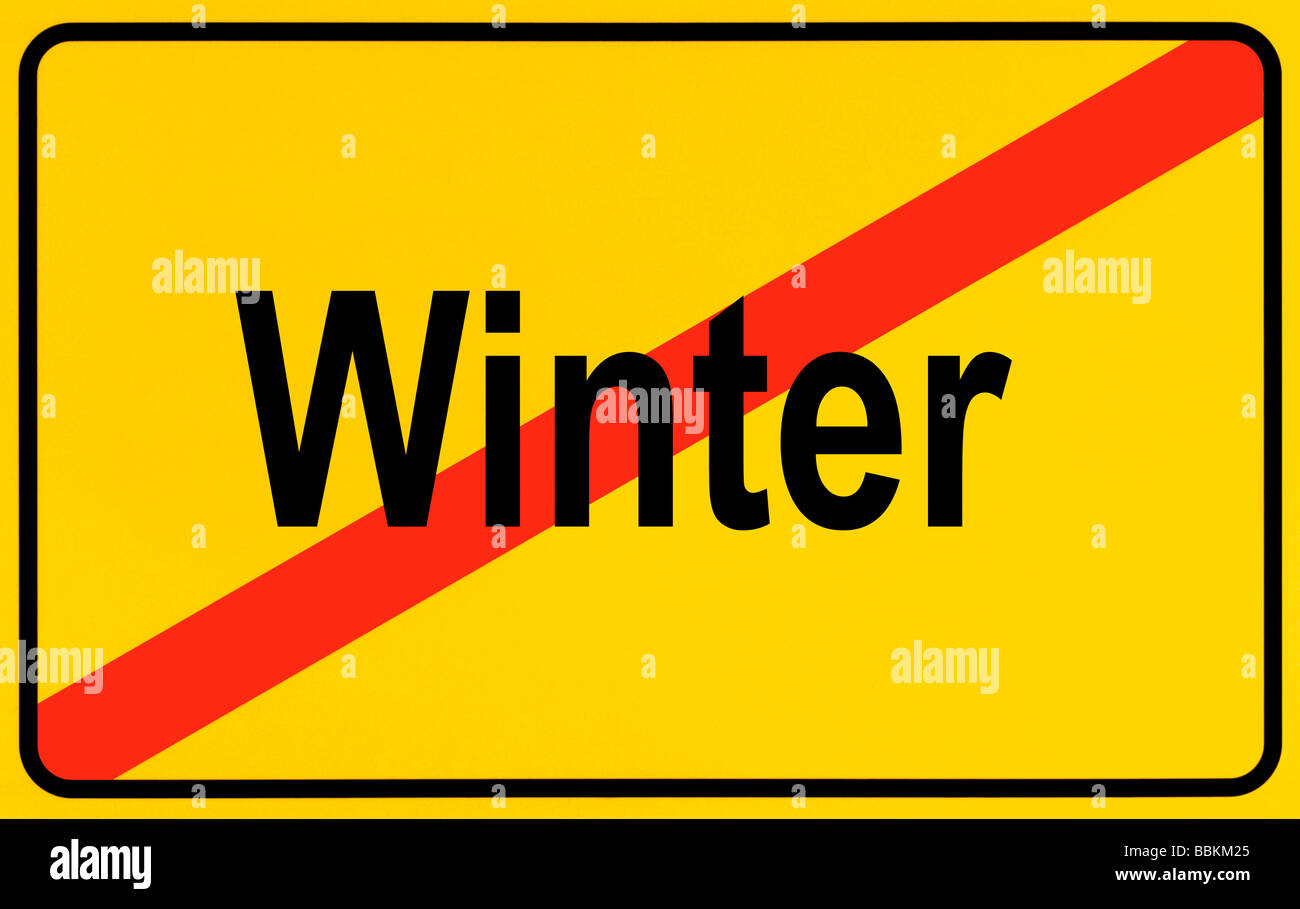 Town exit sign, lettering Winter, symbolic of end of winter - Stock Image