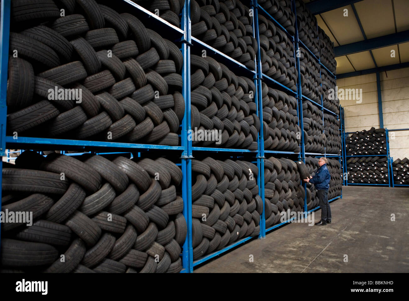 Recycling of tyres The best are stored and shipped to third world countries the bad tires are shredded into granulate Stock Photo