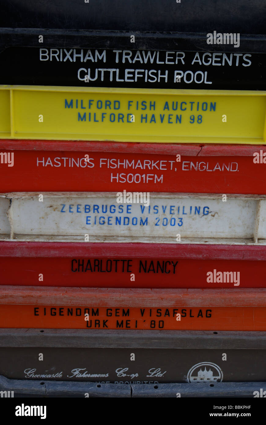 Stacked fish boxes, Quayside, New Quay Harbour, Cardigan Bay, West Wales - Stock Image