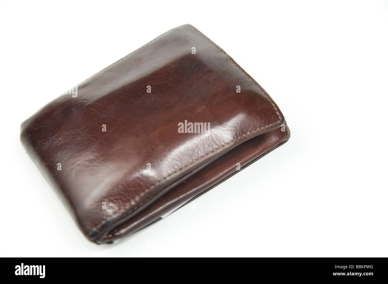 Cutout of a Man's wallet on white background - Stock Image