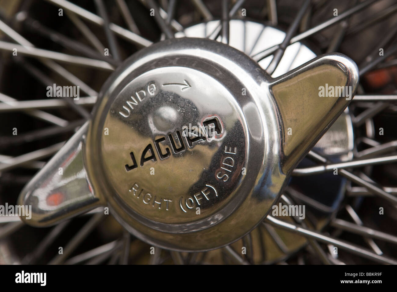 Motoring wheel spinner of classic old British made 1960s E type Jaguar car - Stock Image