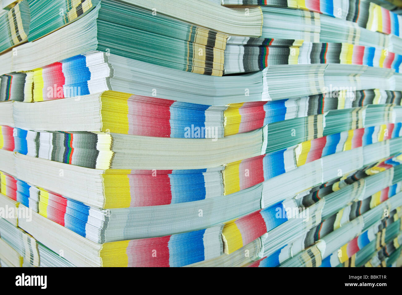 Printing plant, stacked brochures waiting to be processed, detail - Stock Image