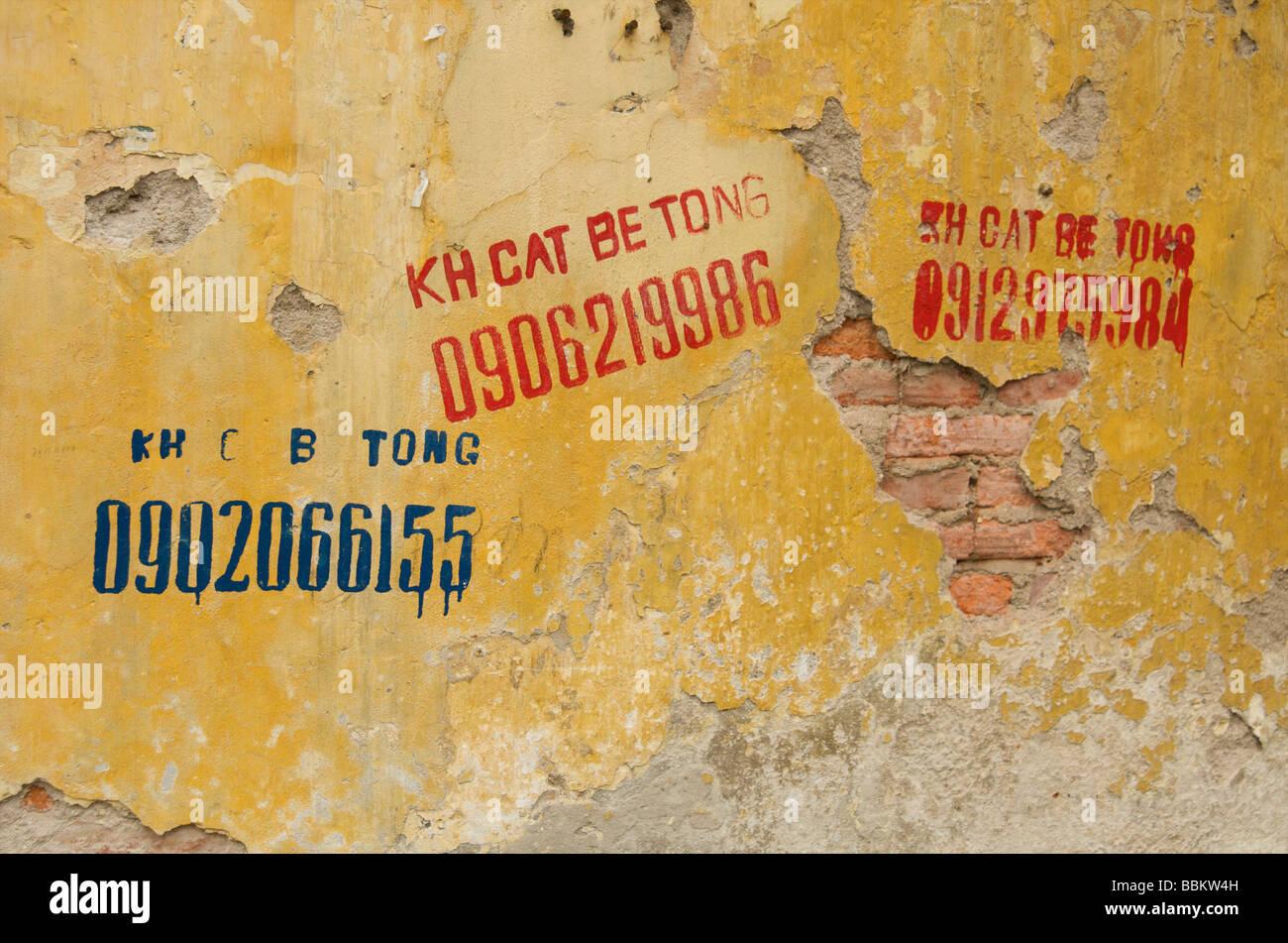 Hanoi wall advertising graffiti and stencils Vietnam Stock Photo ...