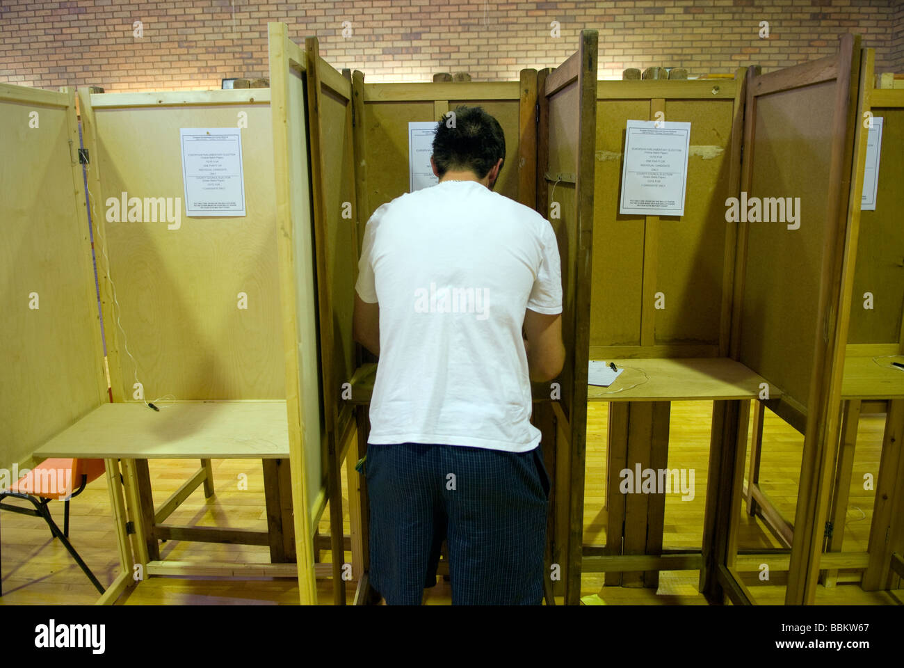 Man casting his vote at Local and European elections, Bordon, Hants, UK. June 2009. - Stock Image