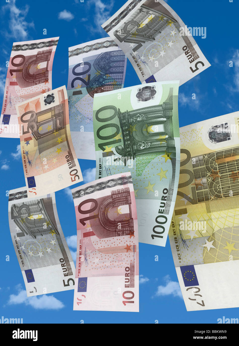 Banknotes raining down from the sky Stock Photo