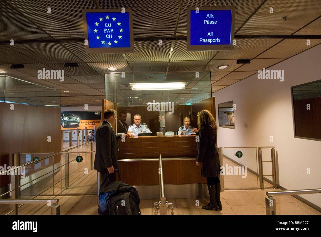 Passport control, security officers, security checks, man, woman, Hamburg Airport, Hamburg, Germany - Stock Image