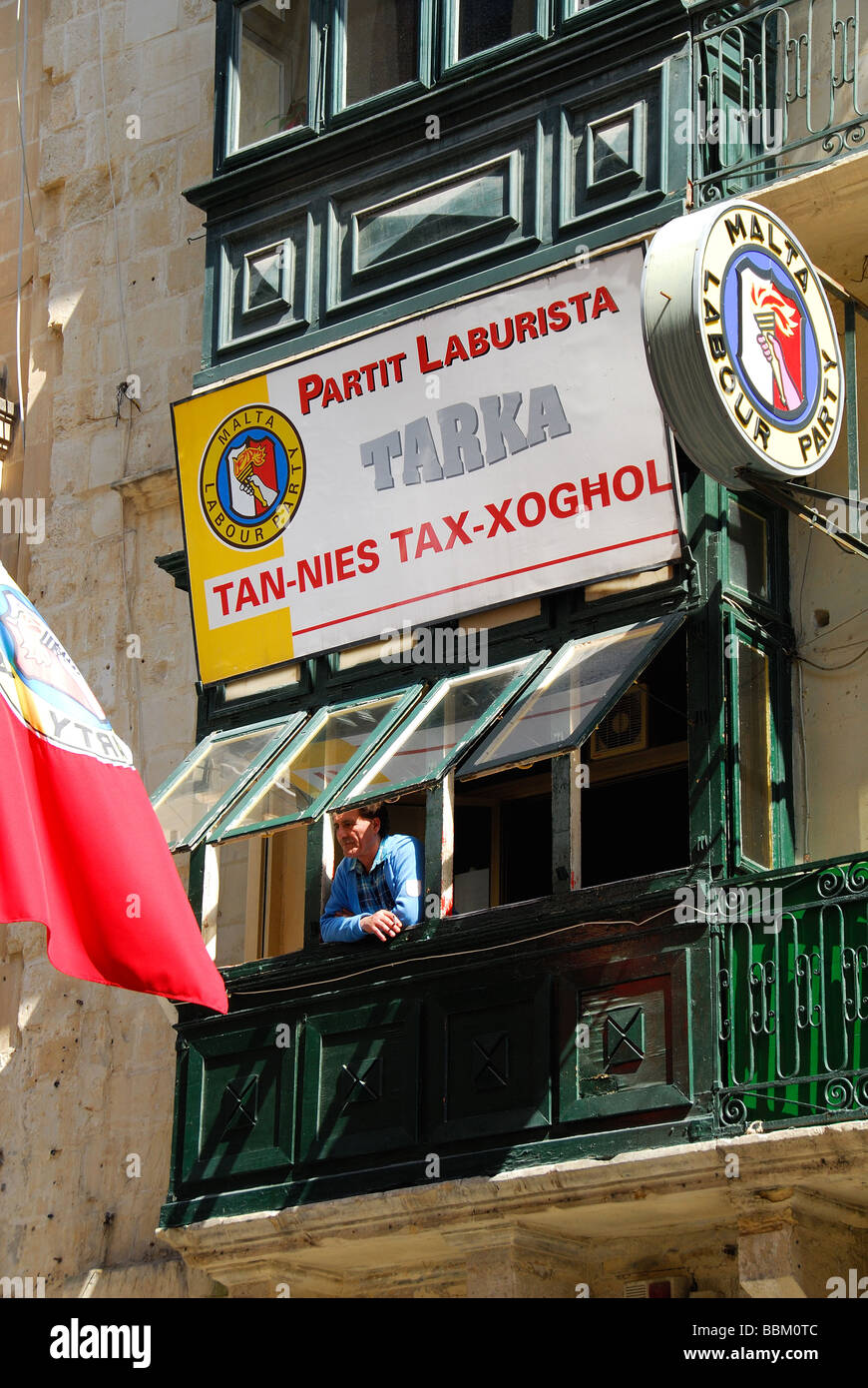 MALTA. A man at the window of the Malta Labour Party headquarters on Republic Street in Valletta. 2009. - Stock Image