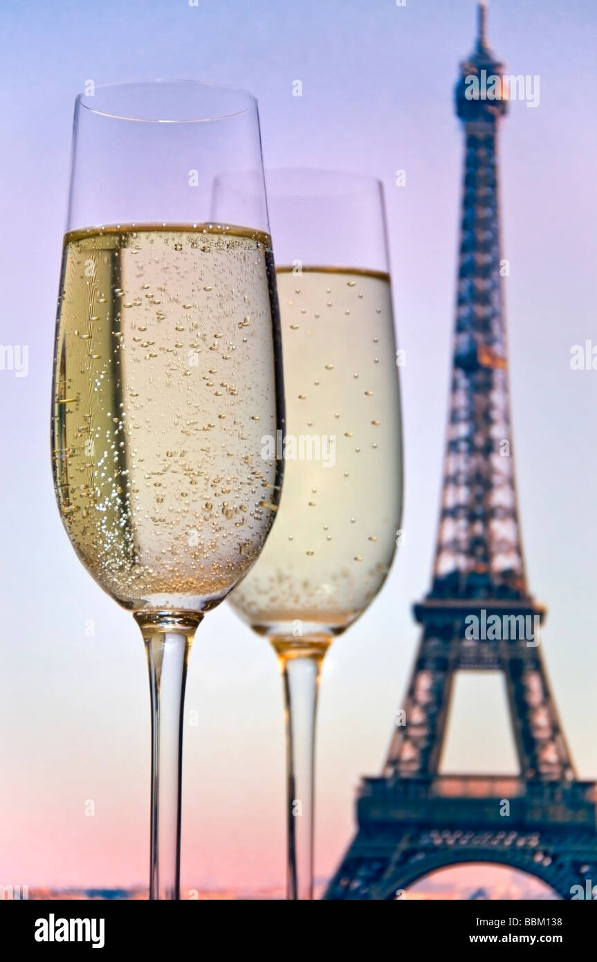 Two glasses of sparkling champagne with the Eiffel Tower ...