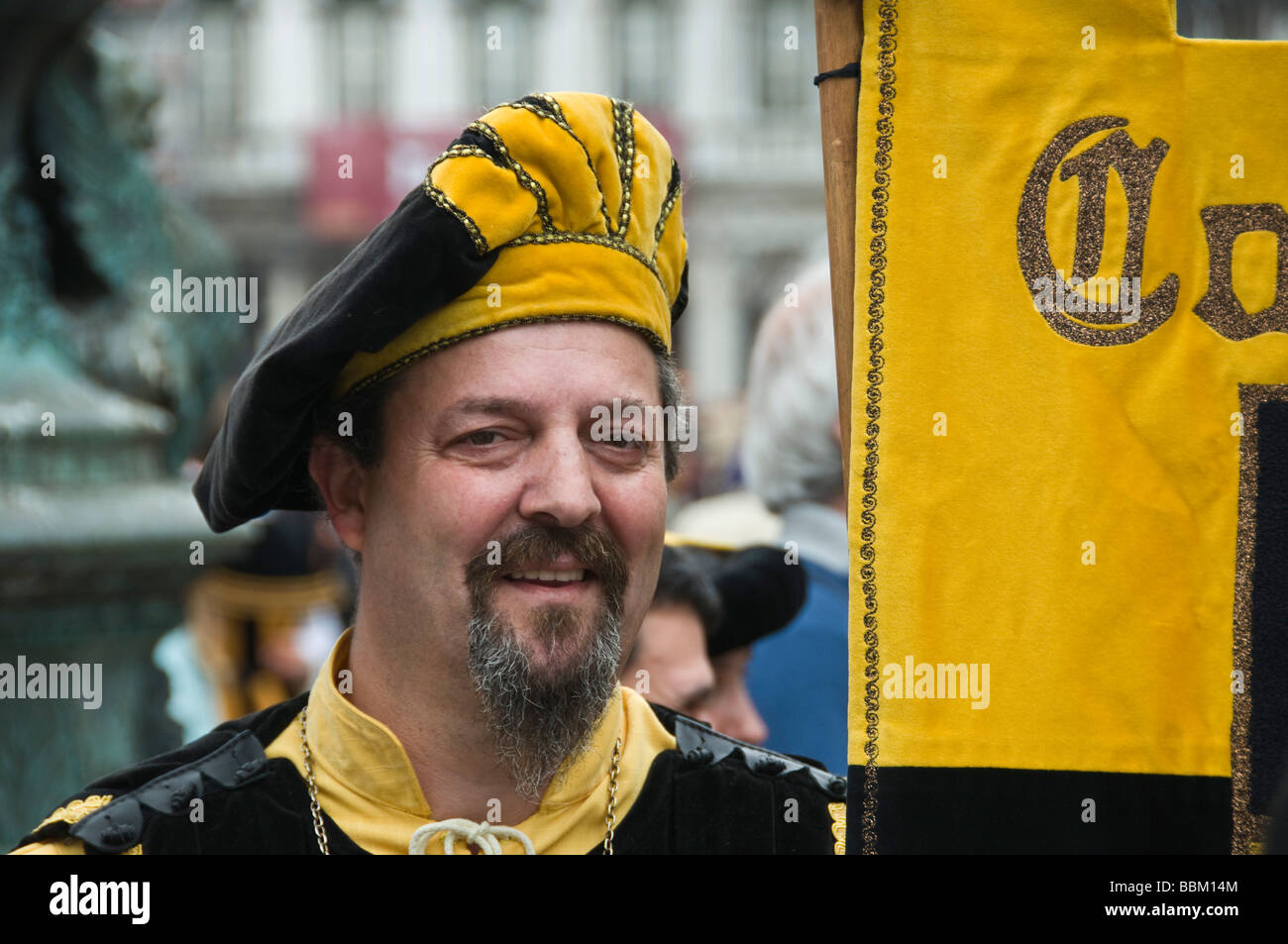 Costumed man in parade Piazza San Marco Venice Italy - Stock Image