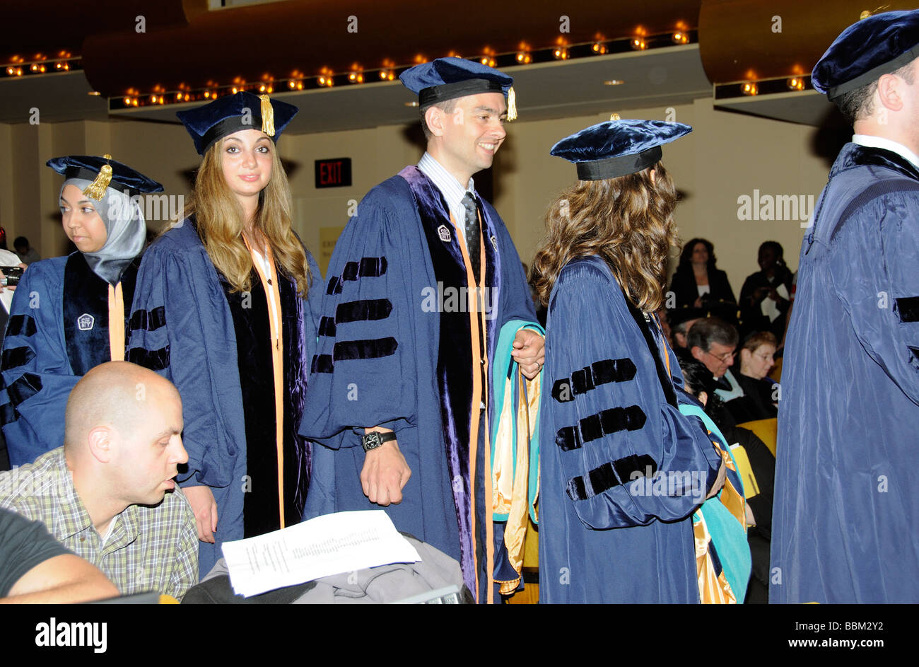 Graduation ceremony doctoral graduates wearing cap and gown in line ...