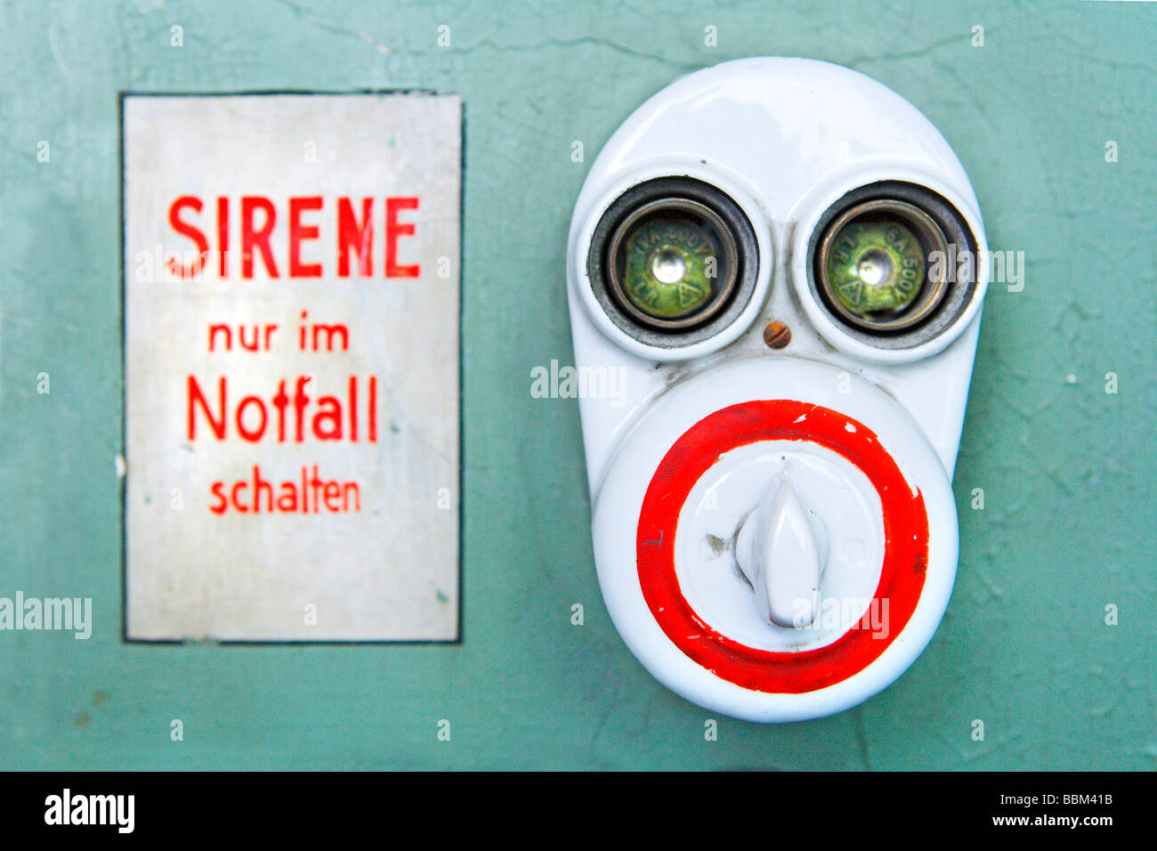 Sirene nur im Notfall schalten, German for Operate siren only in emergency, face, switch, electric switch, fuse, - Stock Image