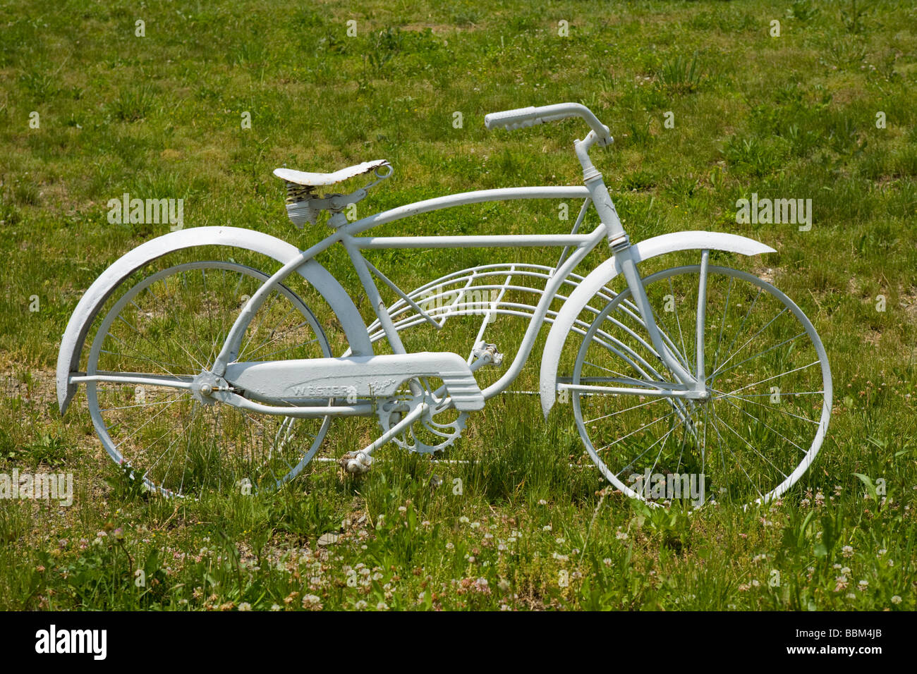White painted bike a whimsical decoration at a bike shop Schuylerville New York Saratoga County - Stock Image