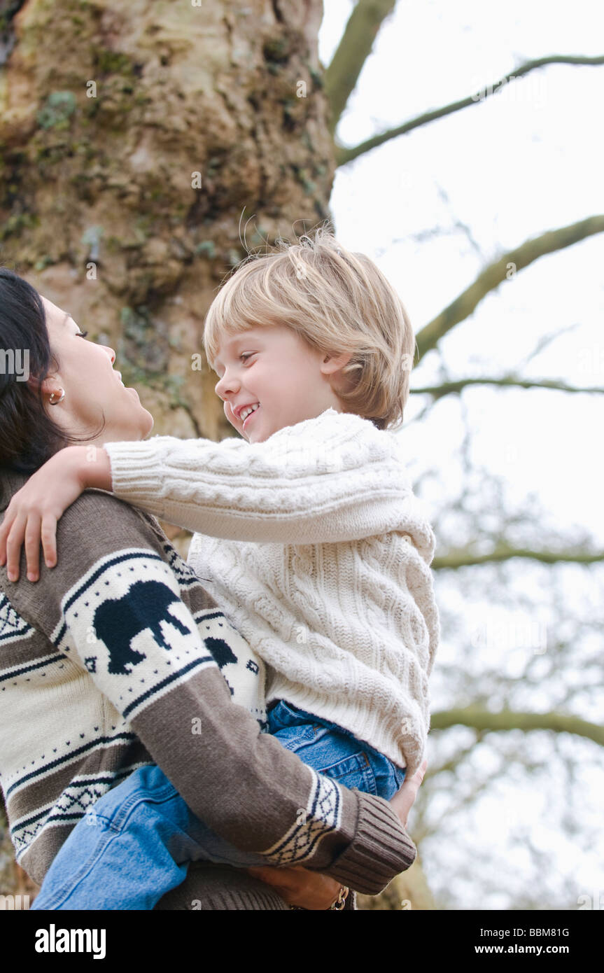 Young mother holds smiling son, Vancouver, British Columbia - Stock Image