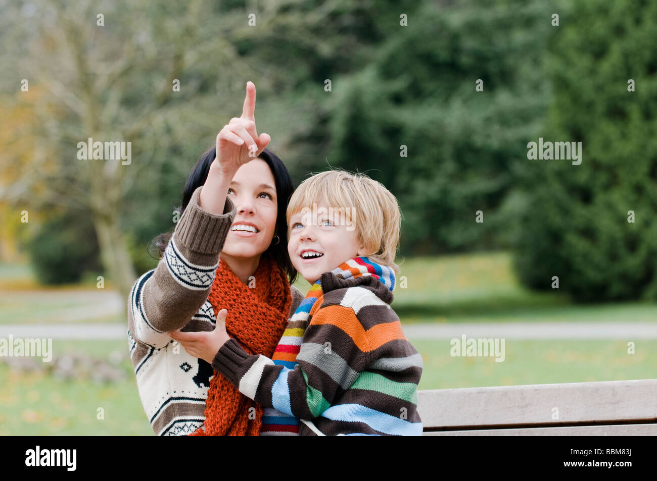 Young woman pointing, boy looking upward, Vancouver, British Columbia - Stock Image