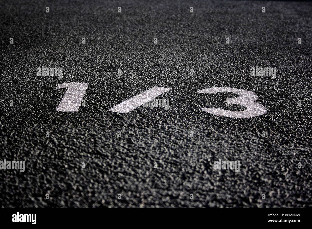 House number 1 / 3 on house wall - Stock Image