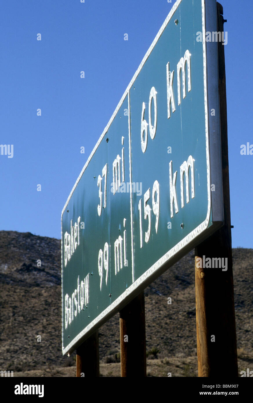 mile km kilometer sign highway mileage distance road measure metric us - Stock Image