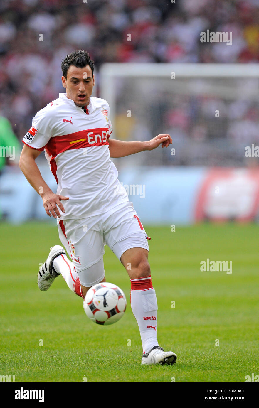 Timo Gebhart, German footballer playing for VfB Stuttgart, leading the ball - Stock Image