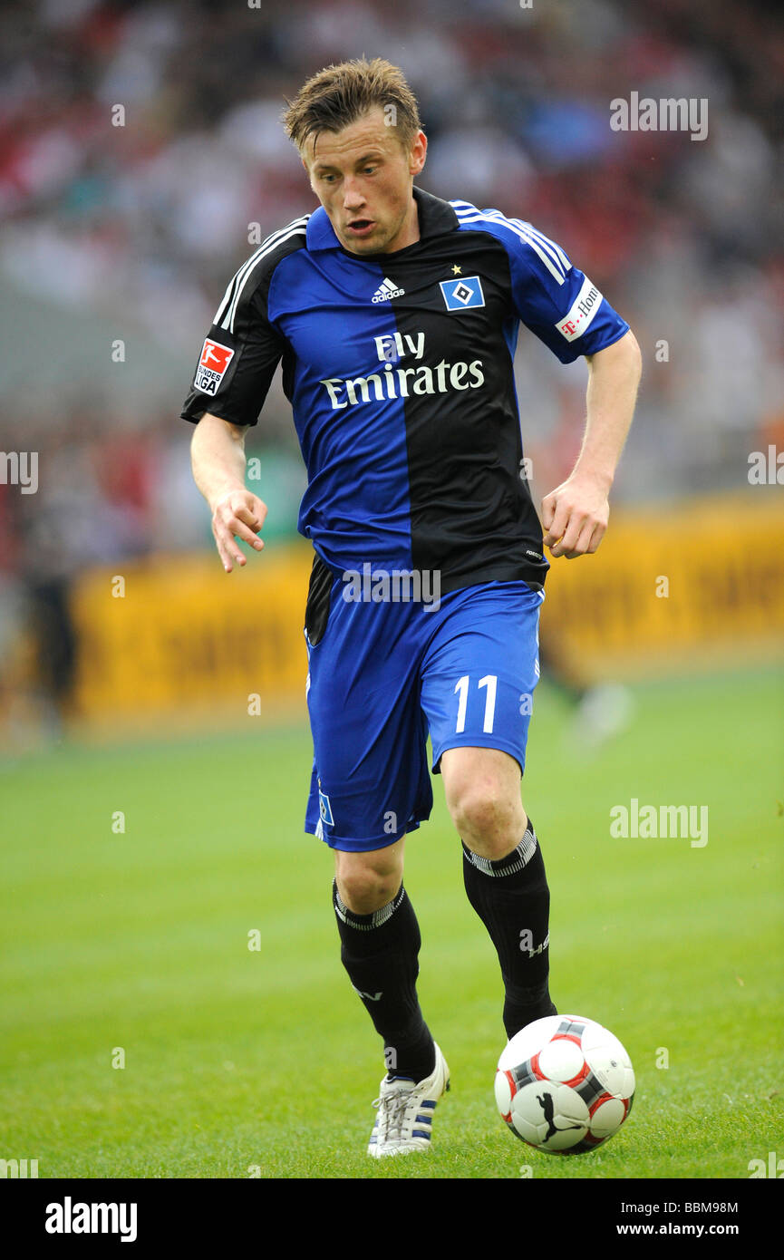 Ivica Olic, German footballer playing for HSV, Hamburger SV, on the ballv - Stock Image