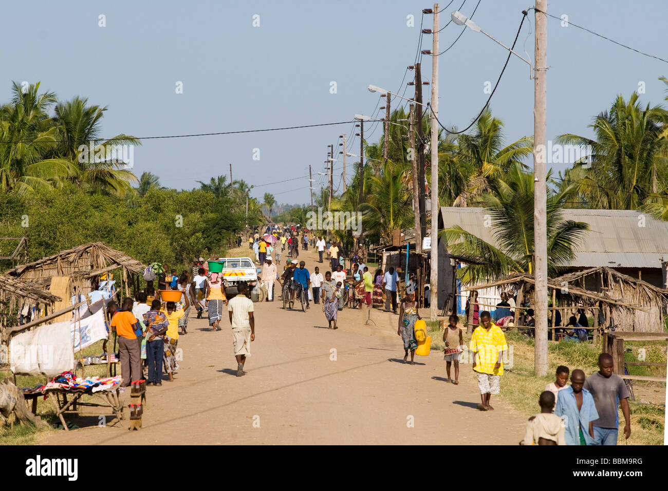 Busy village road on the outskirts of Quelimane Mozambique - Stock Image