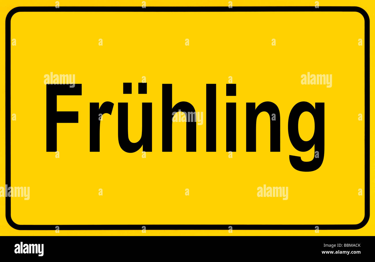 Town sign, German lettering Fruehling, symbolic of beginning of spring - Stock Image