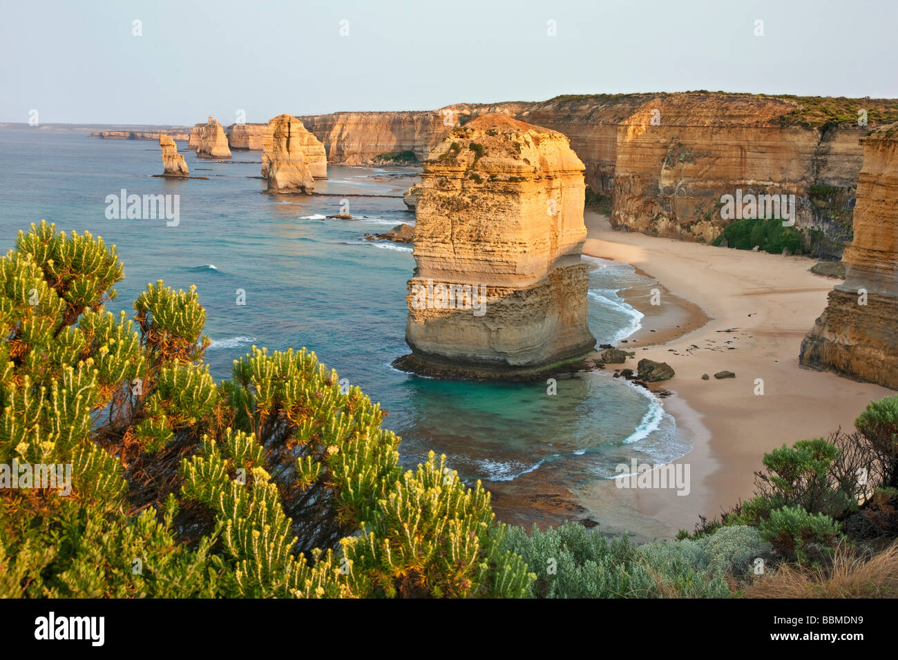 Australia, Victoria. Some of the Twelve Apostles standing in shallow water in the Port Campbell National Park. - Stock Image