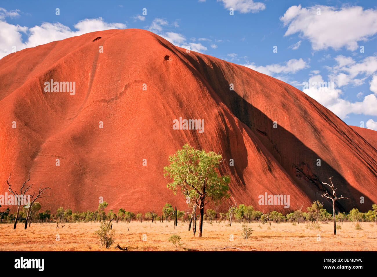 Australia, Northern Territory. Uluru or Ayres Rock, a huge sandstone rock formation. One of the most recognized - Stock Image