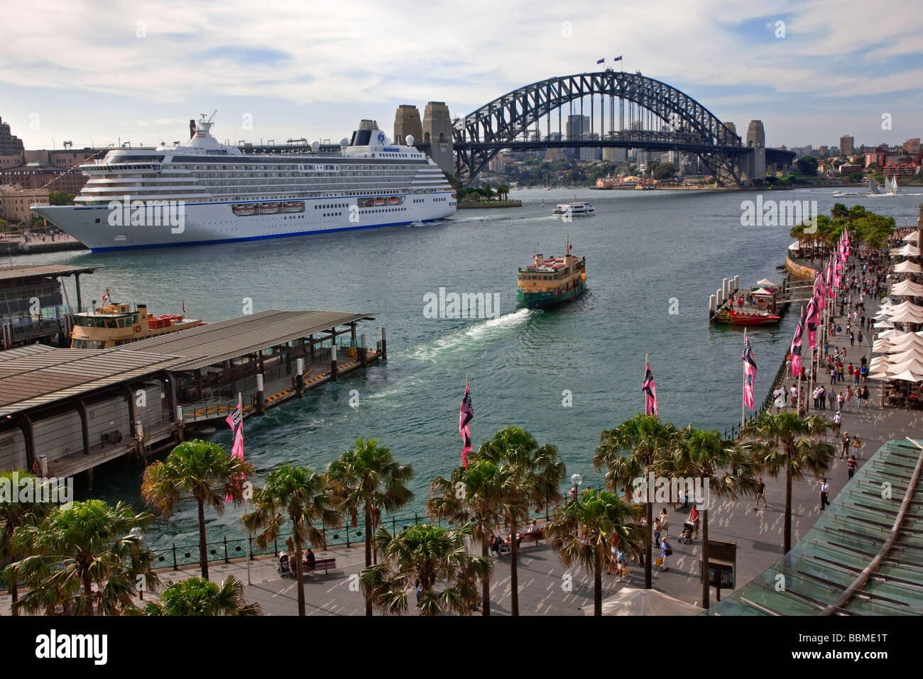 Australia New South Wales. Circular Quay and Sydney Cove with a large passenger liner berthed near Sydney Harbour - Stock Image