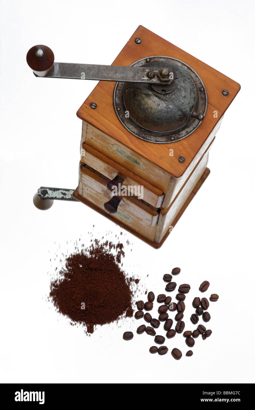 Coffee grinder, grounded coffee, coffee beans - Stock Image