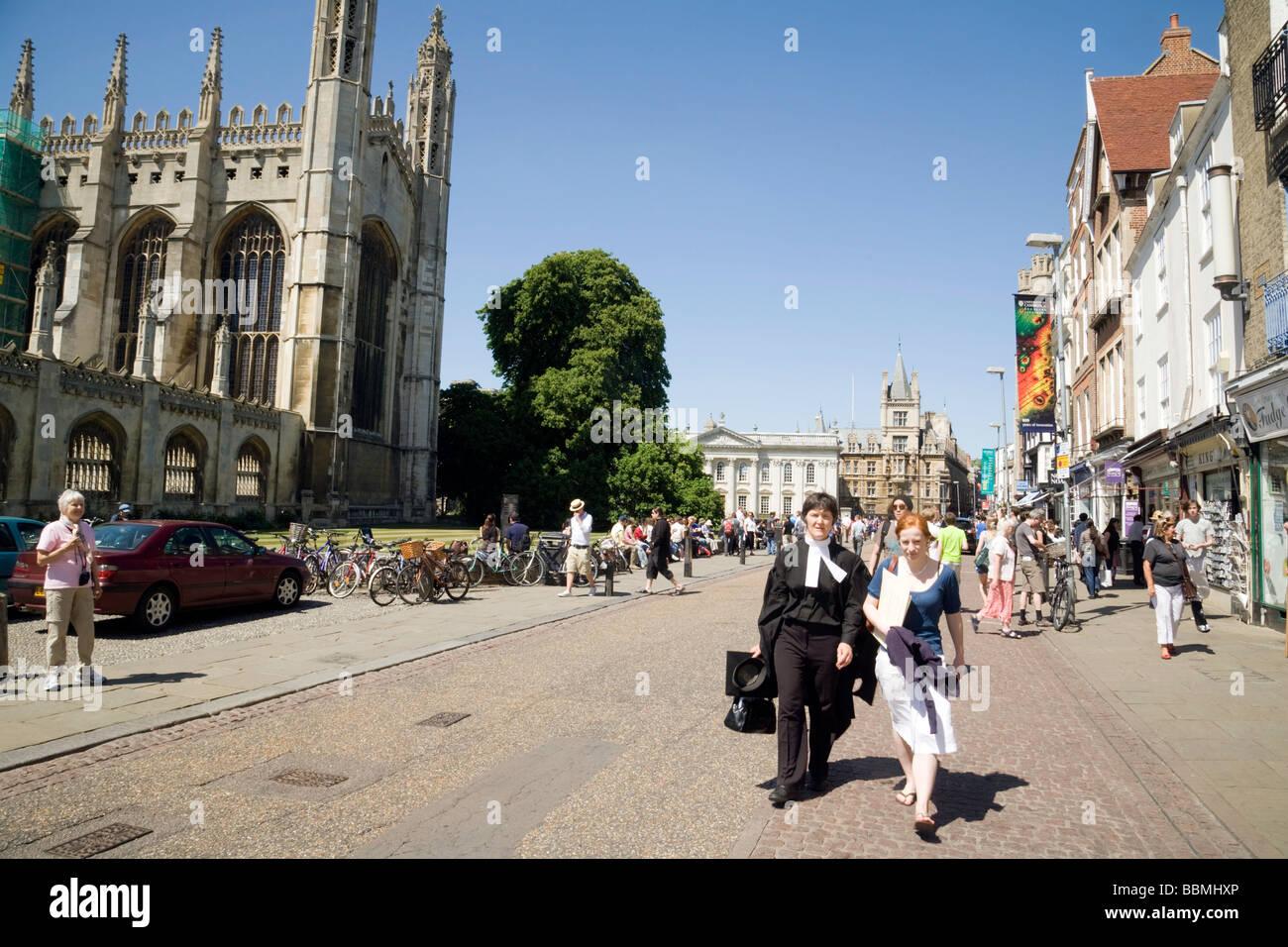 A Cambridge student walking down Kings Parade, Cambridge City Centre, on a sunny day, Cambridge England, Cambridge - Stock Image