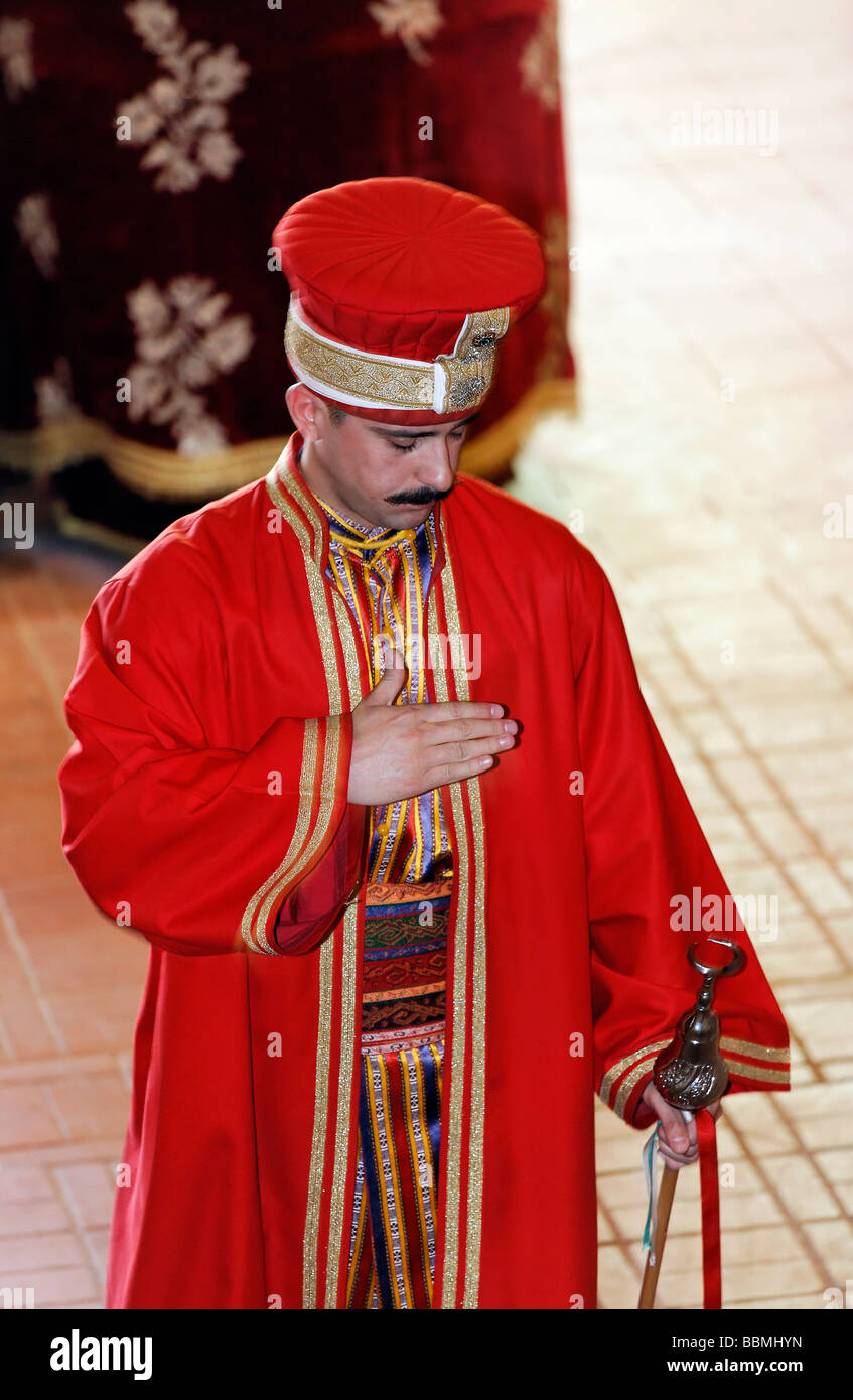 Conductor in historical costume, bows in front of the audience, Janitscharen Military band, Mehter band, show in - Stock Image