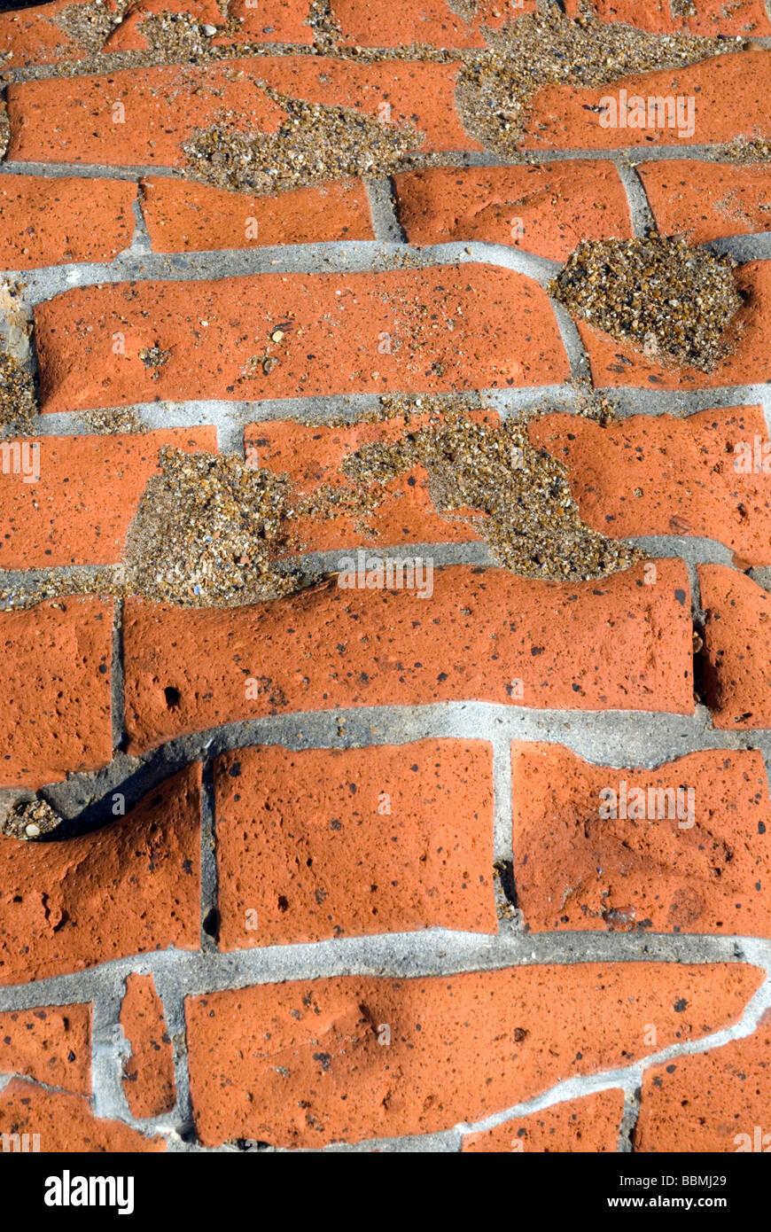 brickwork pattern; bricks worn down by the sea; - Stock Image