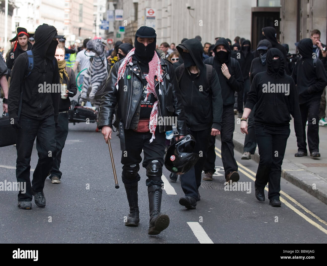 Group of masked anarchists at protest in the City ahead of the G20 summit of world leaders, 1 April 2009 - Stock Image
