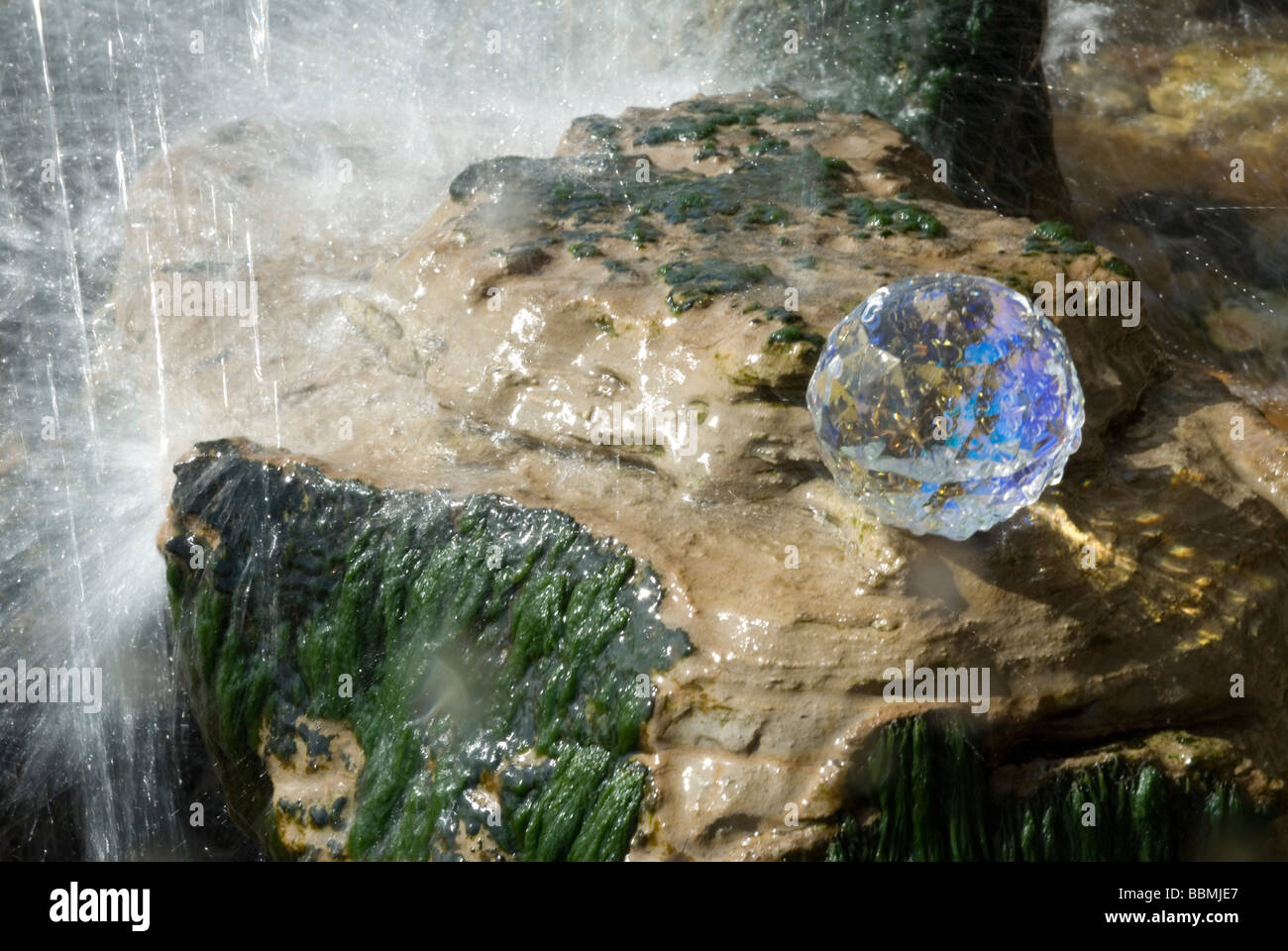 Crystal in waterfall - Stock Image