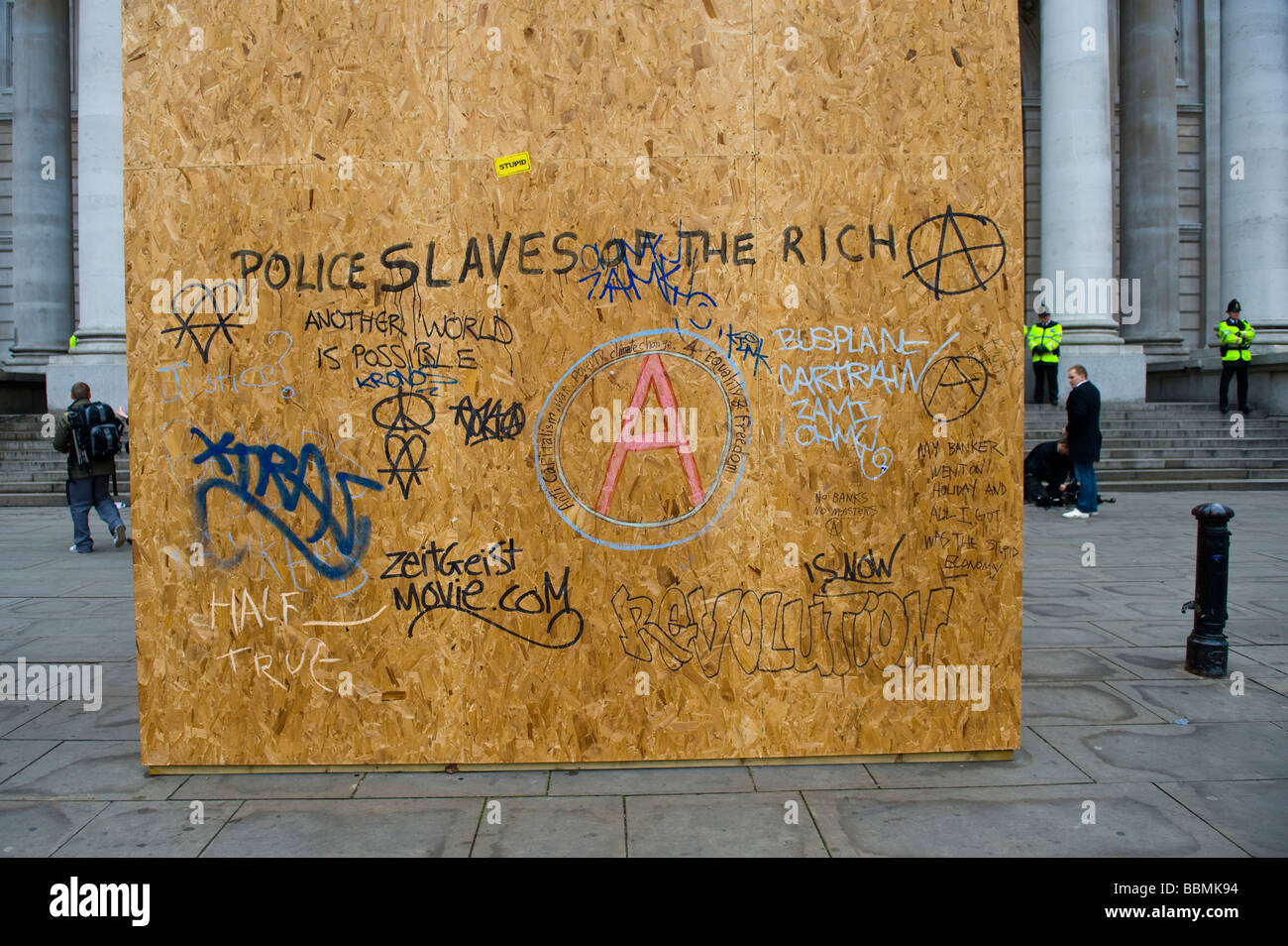 Board with anarchyst symbols in the City of London at protest ahead of the G20 summit of world leaders, 1 April - Stock Image