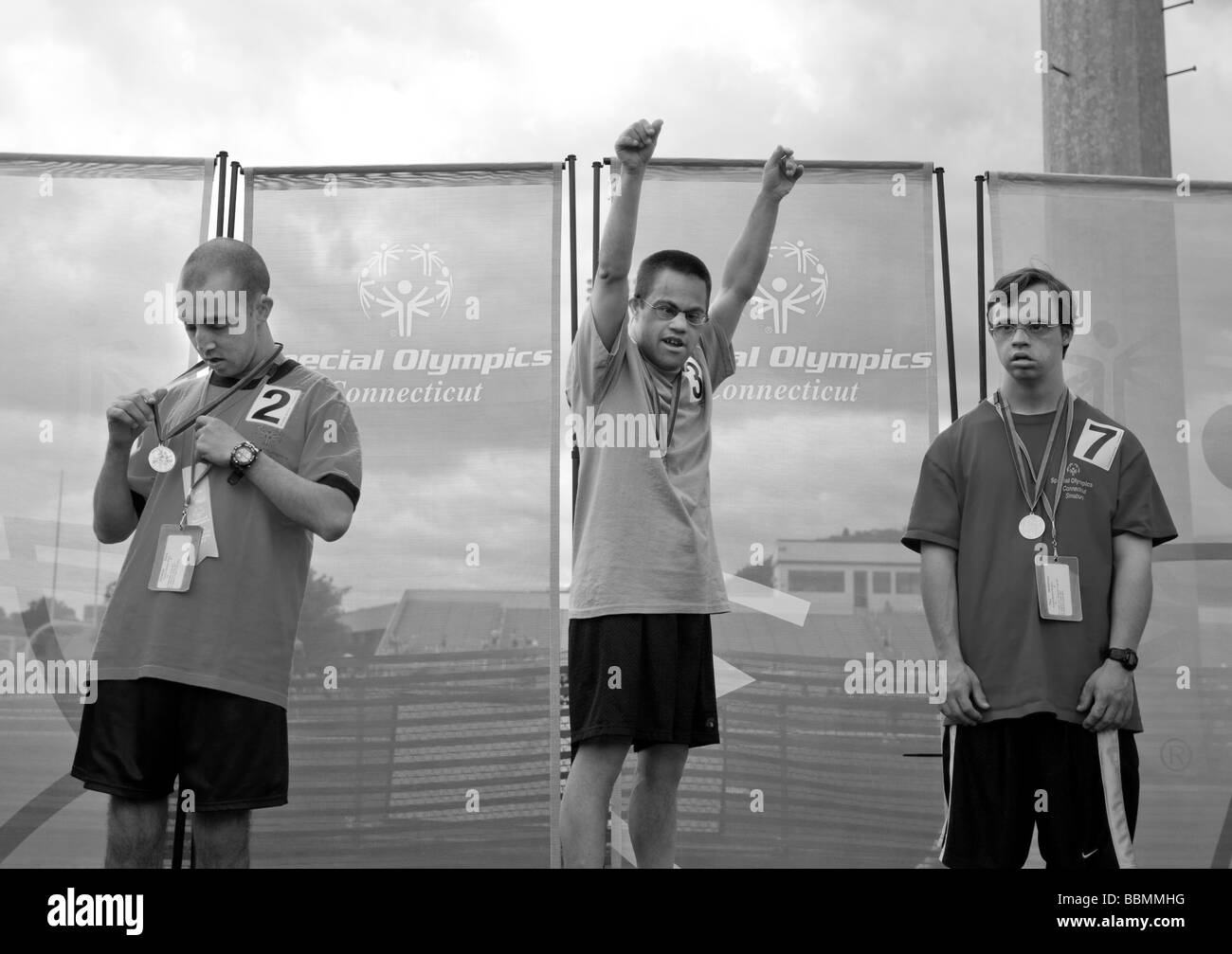 Special Olympians react as they receive medals at an awards ceremony at the Special Olympics Games, New Haven, CT, - Stock Image