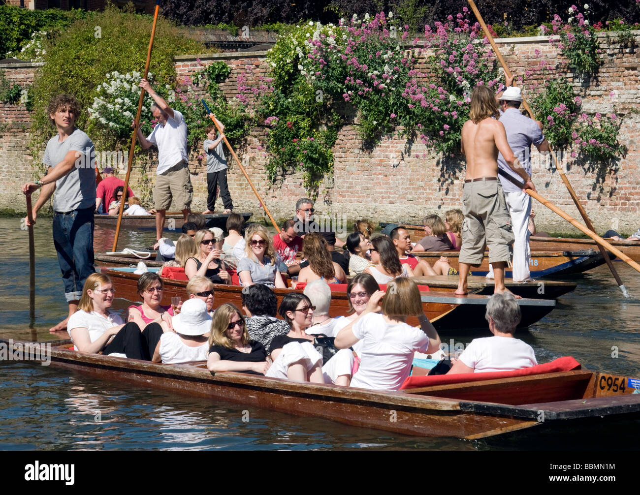 Punting on the River Cam, Cambridge, UK on a sunny summers day - Stock Image