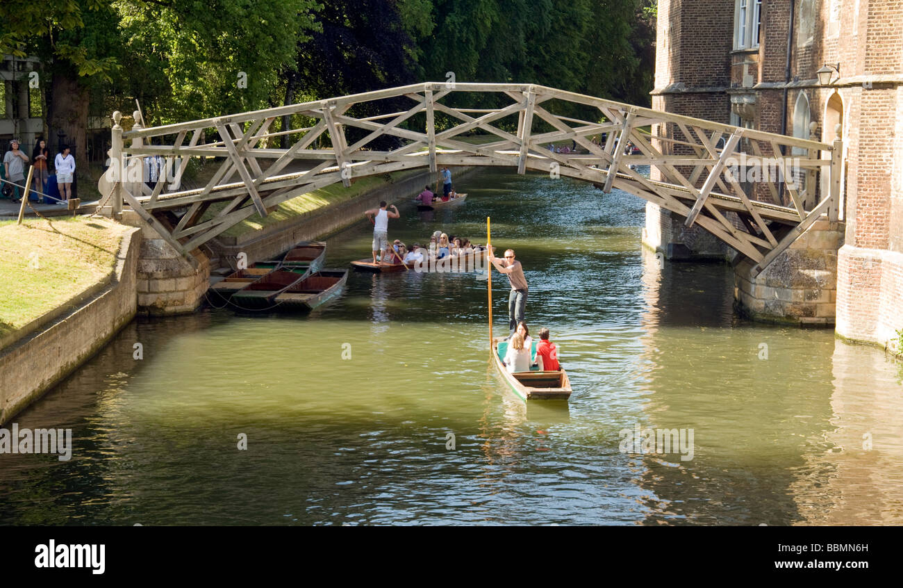 Punting on the River Cam at Newtons bridge, Queens College, Cambridge, UK on a sunny summers day - Stock Image
