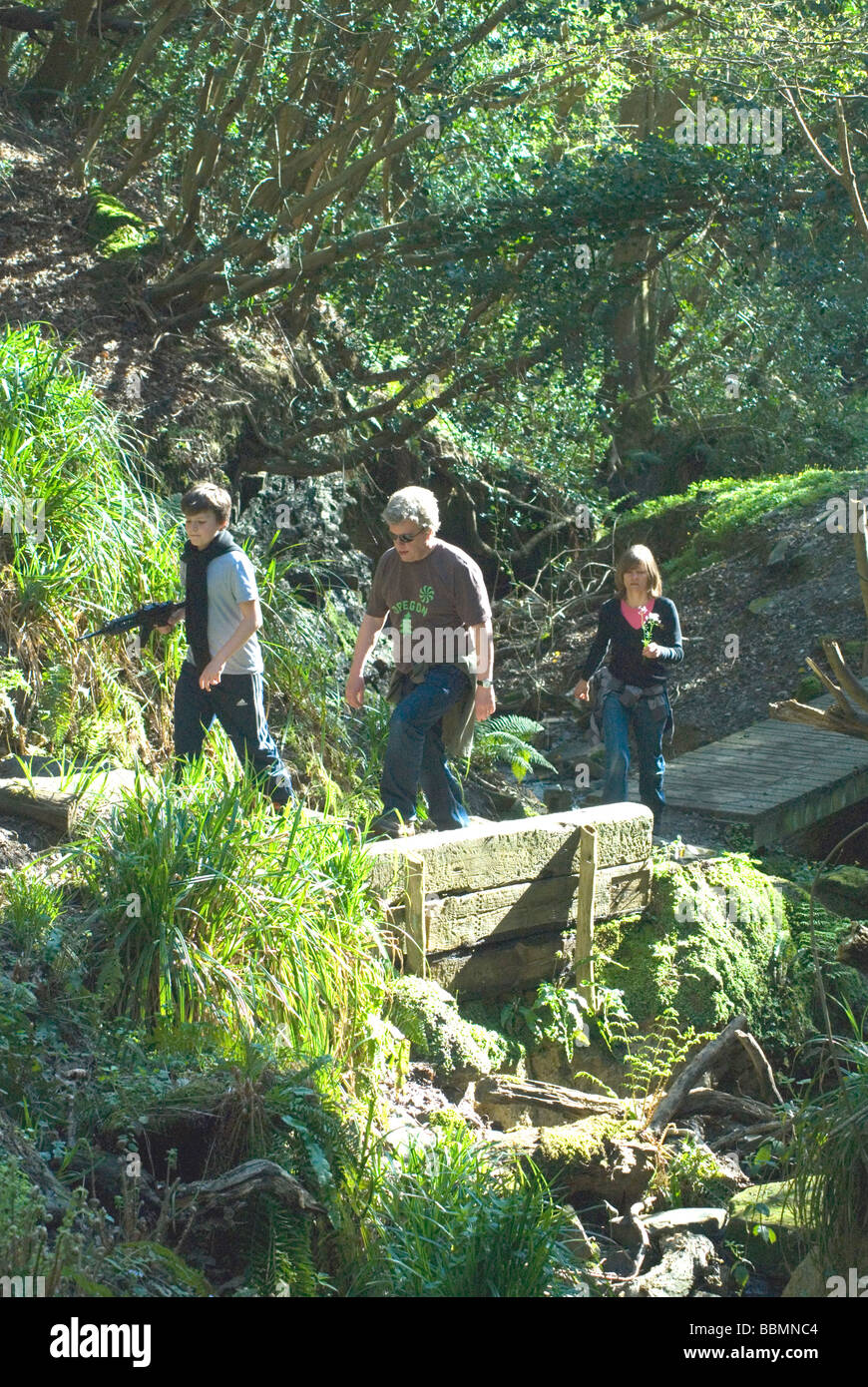 Family walking in Ecclesbourne Glen Hastings Country Park Hastings East Sussex England Stock Photo