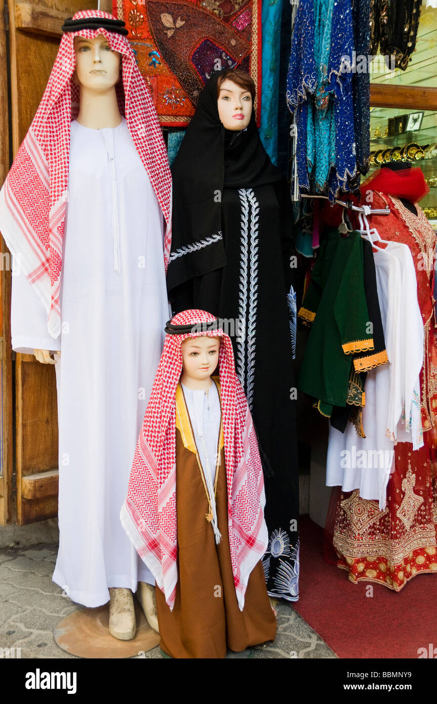 Family of Mannequins in front of a store  Dur Dubai souk - Stock Image