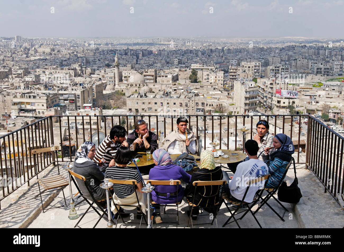 Adolescents smoking a hookah on the hill of the citadel, Aleppo, Syria, Middle East, Asia - Stock Image
