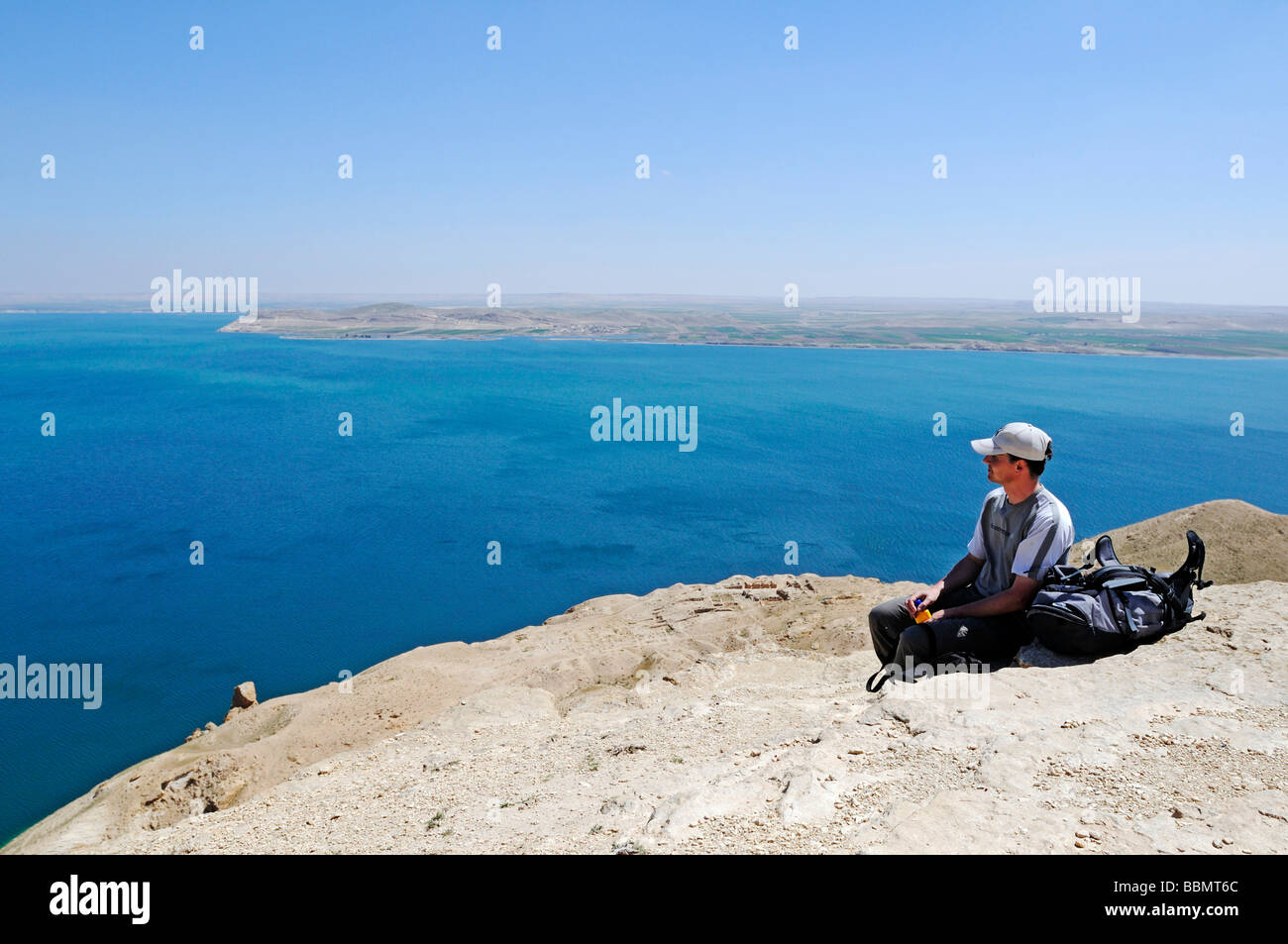 Hikers on the mountain Jebel Arruda, in the back the Asad reservoir of the Euphrates, Syria, Asia Stock Photo